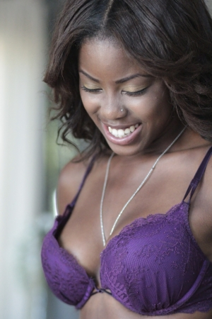 ebony: Beautiful and sexy African-American girl in lingerie smiling