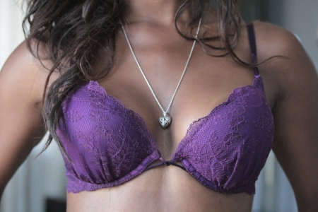 black bra: Beautiful and sexy African-American girl close-up bra and cleavage