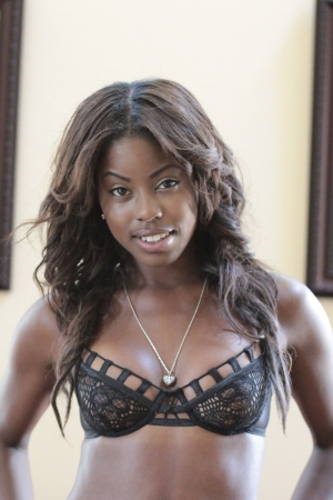 Beautiful young African-American girl in black lace bra lingerie and necklace smiling photo