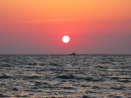 Fantastic crimson sea ocean sunset horison sky photo.