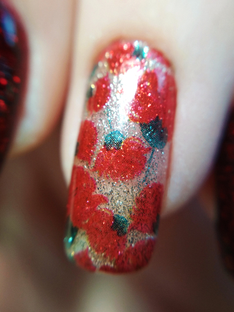 Woman hand finger floral flower golden red green manicure gel nail polish swatch design beauty fashion macro photo.