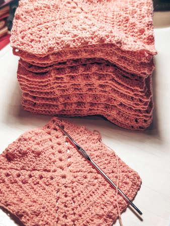 Knitting crochet cotton pink yarn thread hook craft creative closeup macro photo.