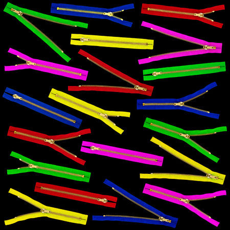 alteration shop: Many coloured zippers before black background