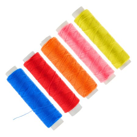 craft material tinker: ive coloured linen thread roles before white background