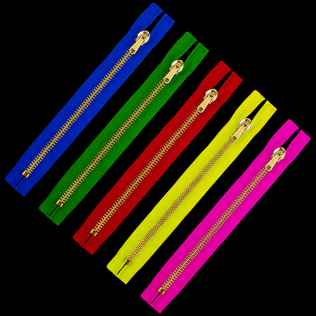 Five colorful zipper closures against black background