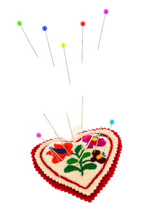 alteration shop: Pincushions with coloured pins Stock Photo