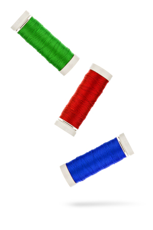alteration shop: Red green blue thread before white background Stock Photo