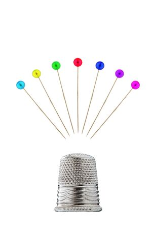 Thimble with pins before white background Stock Photo