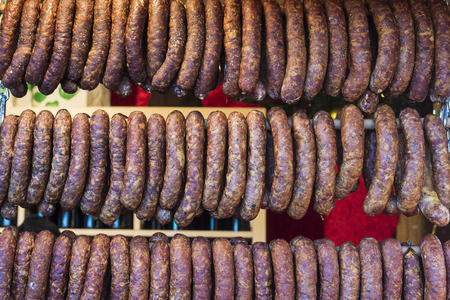 shopping binge: Sausage at market stall for sale