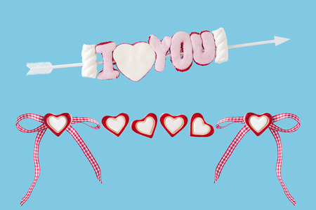 I love you arrow with hearts and loop before blue background