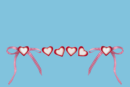 Hearts and loop before blue background