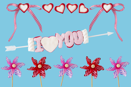 I love you arrow with hearts, loop and wind turbines before blue background Stock Photo