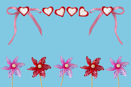 Hearts and wind turbines before blue background Imagens
