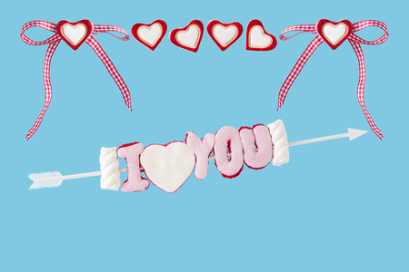 I love you arrow with hearts before blue background