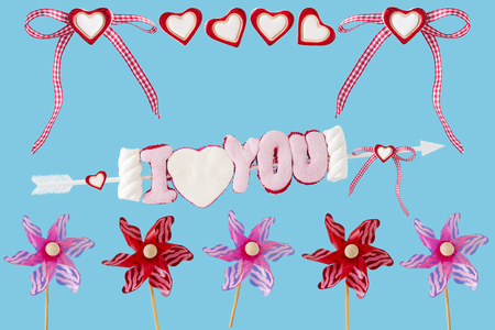 I love you arrow with hearts and wind turbines before blue background