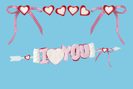 I love you arrow with big and small hearts before blue background