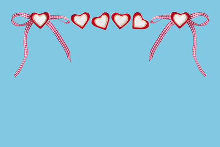 Hearts and checked loop before blue background