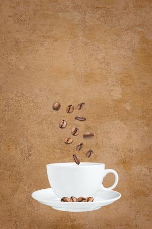 Coffee cup and coffee beans Фото со стока