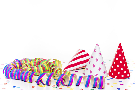 Three party hats with colorful confetti