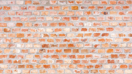 An old weathered brick wall for a background Stock Photo