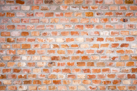 An old weathered red brick wall as a background Stock Photo