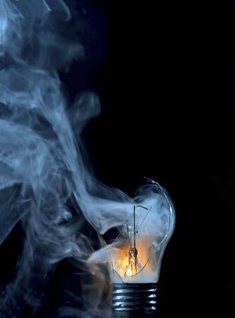 Detail of the cracked and smoking bulb
