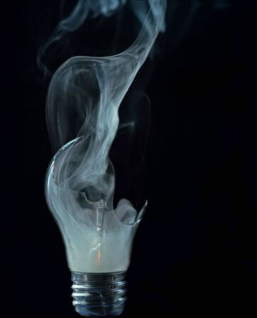 anomalous: Detail of a cracked bulb with smoke Stock Photo