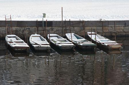 fishingboats: snowy fishing-boats Stock Photo
