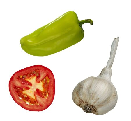 ailment: vegetables - slice of tomato, garlic and green pepper Stock Photo