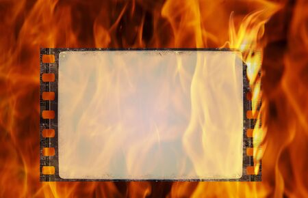 Burning old film frame in grunge style Stock Photo - 5303421