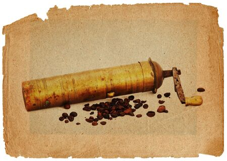 Antique coffee grinder with coffee beans photo