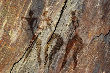 Primitive figures of women on the rock