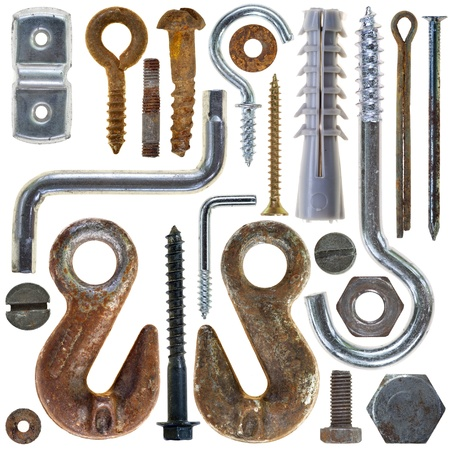 bolts and nuts: rusty screws heads bolts nuts on white background Stock Photo