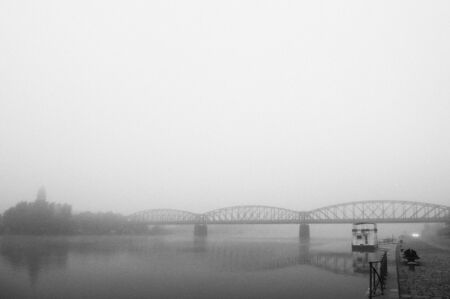Prague railway bridge in early morning fog photo