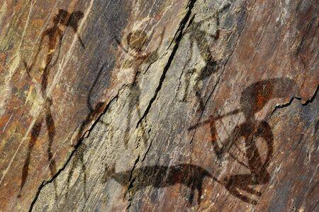 cave painting: Figuras primitivas en la roca parece pintura rupestre Foto de archivo