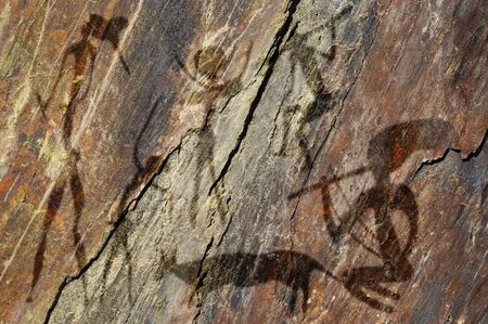 Primitive figures on the rock looks like cave painting Stock Photo - 18855944
