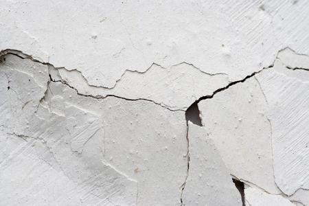 weatherworn: cracked stucco - abstract grunge background