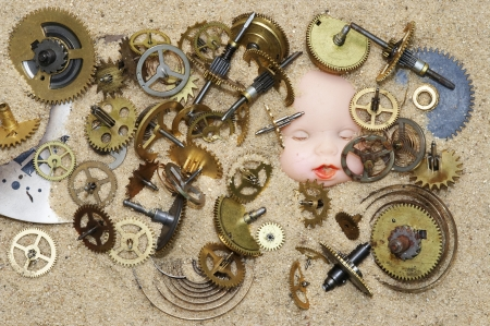 Detail of the clockwork mechanism on the sand and puppy head Stock Photo