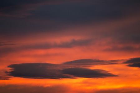 duskiness: dark cloud on red sky Stock Photo