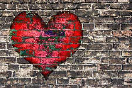 walling: heart on the old broken brick wall Stock Photo