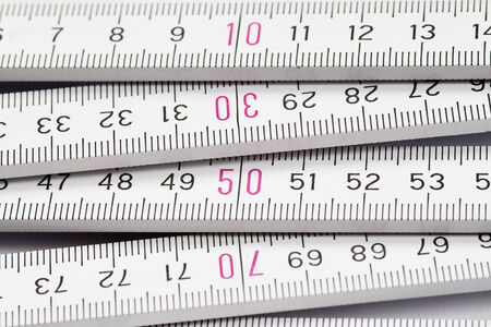 cm: folding meter rule - measure twice, cut once Stock Photo