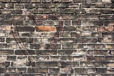 heart on the old broken brick wall photo