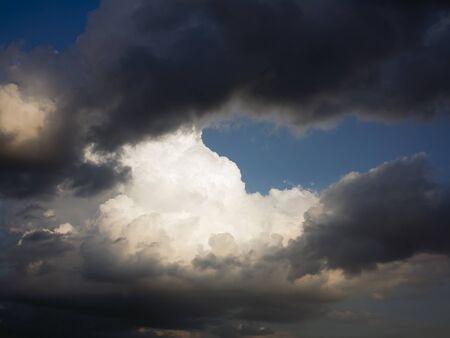 lurid: Dark and white clouds Stock Photo