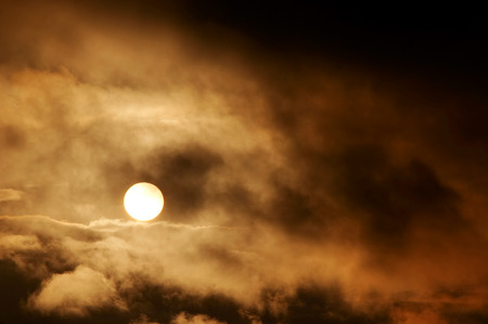 gloaming: Dark storm clouds and setting sun Stock Photo