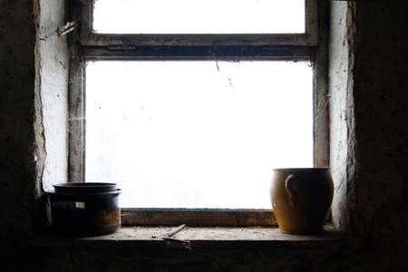plainness: Old pots and stoneware jar on window