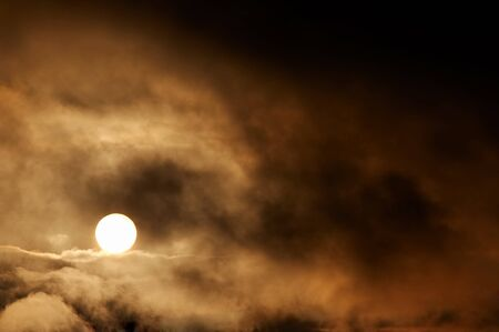 mood moody: Dark storm clouds and setting sun Stock Photo