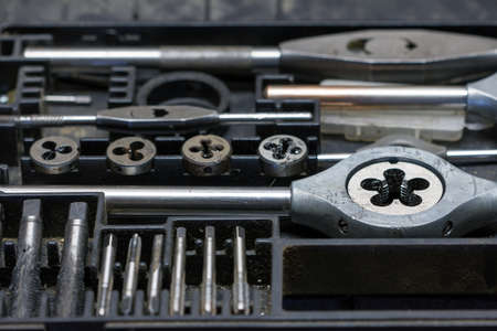 handy man: Detail of the screw taps - hand tool