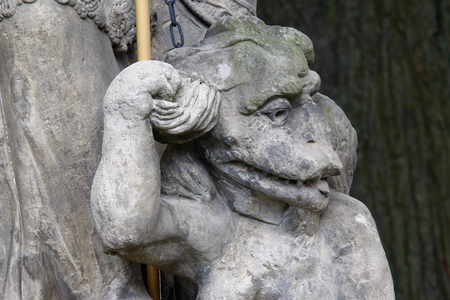 bounded: Baroque statue on the crossroad - Saint Procopius with bound devil