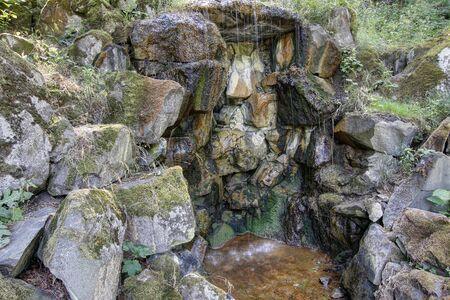 ferruginous: Detail of the mineral water spring - ferruginous water Stock Photo