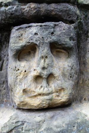 levy: Scary Stone Heads - rock sculptures of giant heads carved into the sandstone cliffs in the pine forest above the village Zelizy in the district Melnik, Czech republic. It is the works of sculptor Vaclav Levy, who created in the period 1841-1846.
